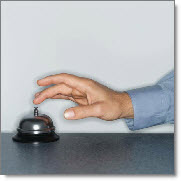 Man ringing bell on counter for service